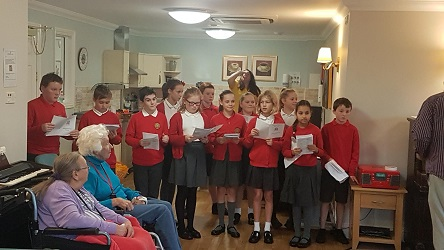 Year 6 singing in the community